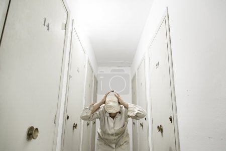 Photo for Woman with bandaged storage white coat, fear - Royalty Free Image