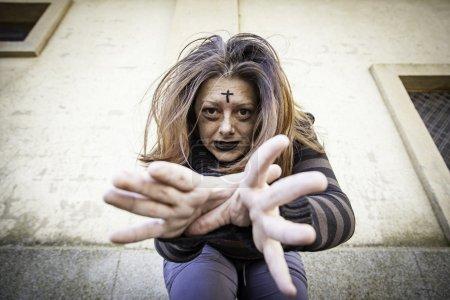 Satanic assaulting girl