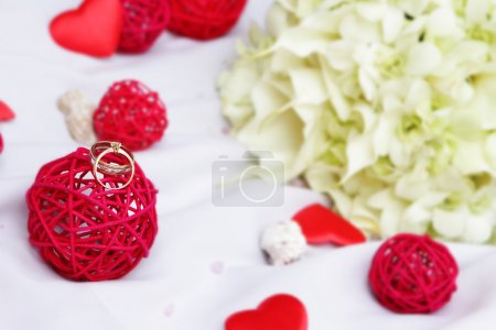 wedding rings, decoration and bridal bouquet isolated over white
