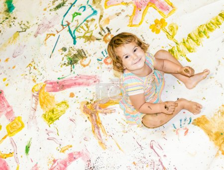 Cute young child girl painting