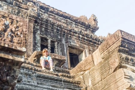 young happy child girl tourist in angkor wat, cambodia