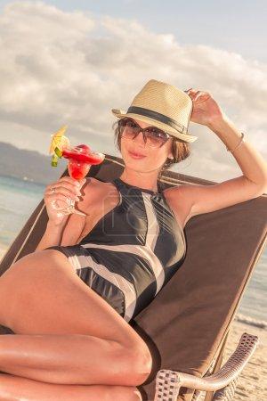 young beautiful woman enjoying summer vacations on tropical beac