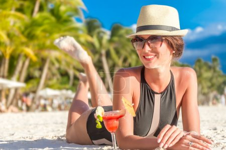 Photo for Young happy beautiful woman enjoying summer vacation on tropical sand beach, sunbathing, outdoor portrait - Royalty Free Image