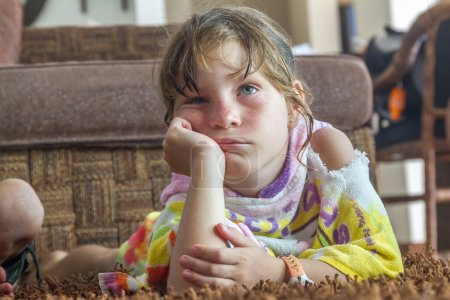 young child girl watching tv at home