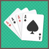 Four aces on poker table