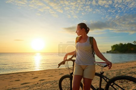 Traveler girl with backpack enjoying view of beautiful  island a