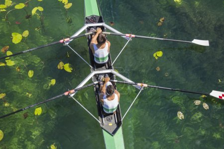 Two rowers  rowing