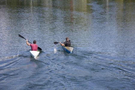 Two men in a canoes