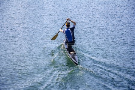 Man rowing in a canoe