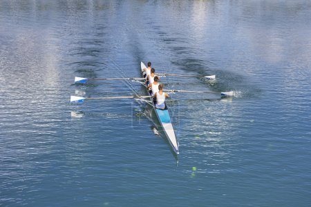 Four men rowing