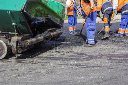 Workers on Asphalting road
