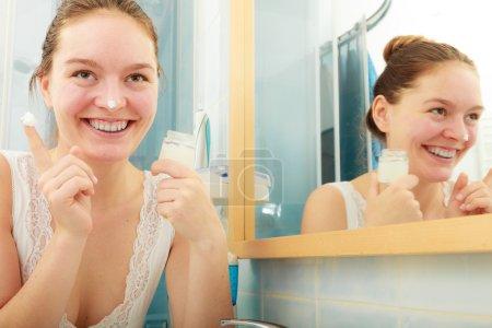 woman applying  moisturizing skin cream