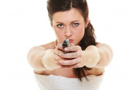 Woman in white dress holding gun
