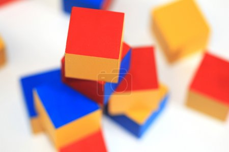 Wooden toy. Colorful brick.