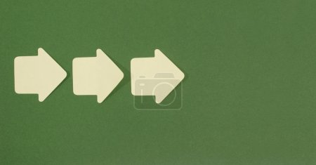 Paper arrows pointing forward.