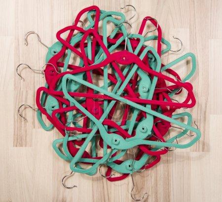 Pile of hangers on the floor.