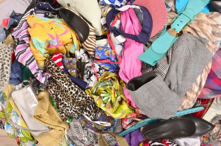 Close up on a big pile of clothes and accessories thrown on the