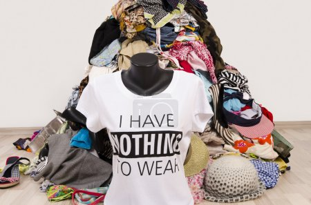 Photo for Untidy cluttered wardrobe with colorful clothes and accessories, many clothes and nothing to wear top on a mannequin. - Royalty Free Image