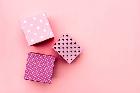 Photo for Gift boxs on paste pink background. Christmas and holiday minimal concept idea. - Royalty Free Image