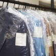 Dry cleaning things hanging in a row on a hanger...