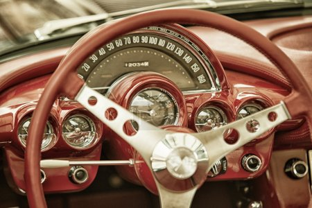 Sleza, Poland, August 15, 2015: Close up on Corvette vintage car steering wheel and kockpit on  Motorclassic show on August 15, 2015 in the Poland