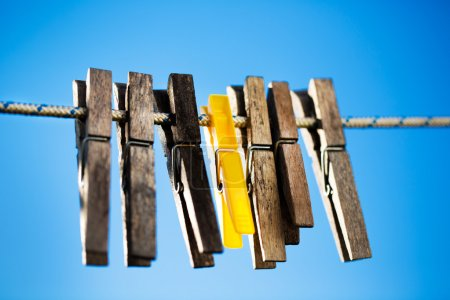 wooden pegs hanging on a rope