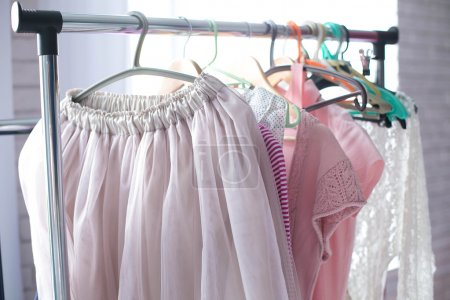 Photo for Pink female clothes hanging on the hangers - Royalty Free Image
