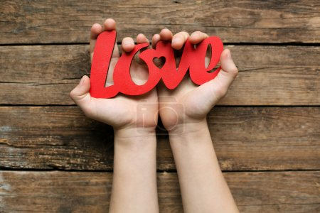 Photo for Love symbol in the hands. St. Valentines concept - Royalty Free Image