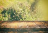 front rustic wood boards and abstract forest background. vintage filtered and toned