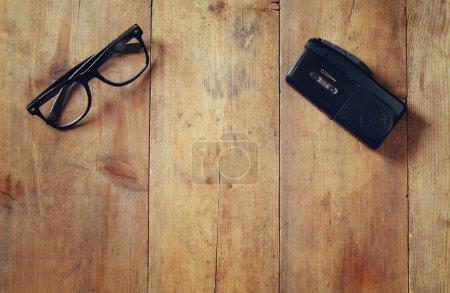 investigation concept. tape recorder and glasses