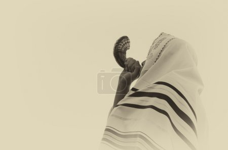 Jewish man blowing the Shofar (horn) of Rosh Hashanah (New Year).