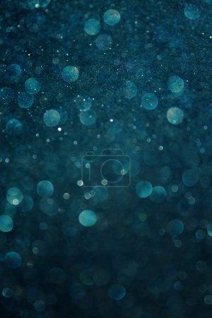 Dark blue abstract background. defocused bokeh lights