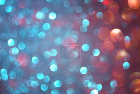 Glitter vintage lights background. blue, brown and purple mixed colors. defocused