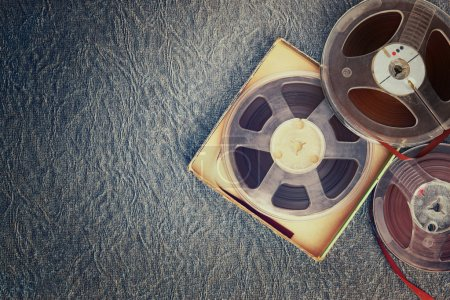 Top view of old sound recording tape, reel to reel type and box.