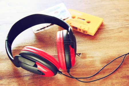 Top view of vintage headphones and cassettes