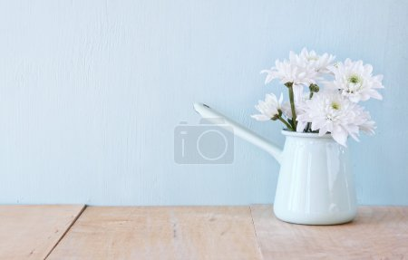 Summer bouquet of flowers on the wooden table with mint background. vintage filtered image