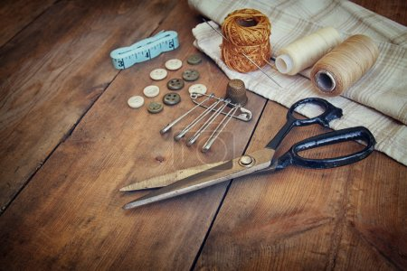 Vintage Background with sewing tools and sewing kit over wooden textured background