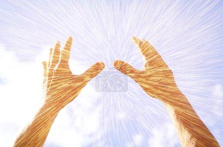 Hands raised in prayer against sky. double exposure effect
