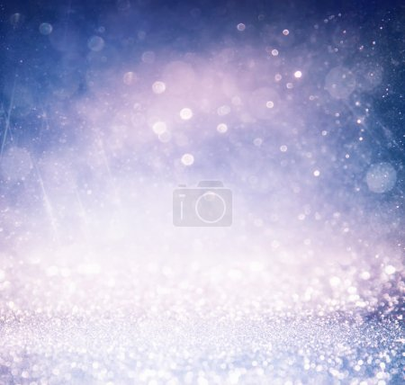 glitter vintage lights background. light silver , gold, purple and black. defocused.