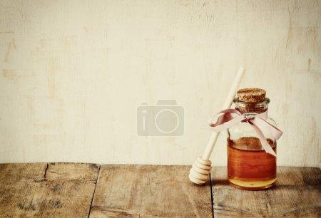 abstract filtered image of honer glass jar. rosh hashanah (jewesh holiday) concept.  traditional holiday symbols.