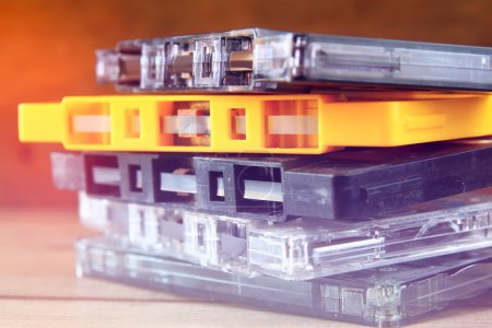 close up photo of stack of Cassette tapes over wooden table . retro style image
