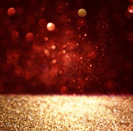 abstract background of red and gold glitter bokeh lights