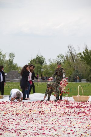 Soldiers assigned to scatter flower petals at the eternal flame of the monument to genocide armyan.Tsitsernakbert. April 27, 2015
