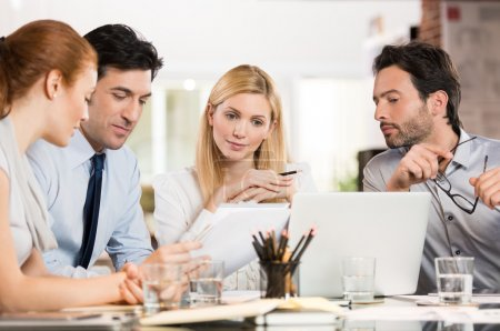 Businesspeople analyzing documents