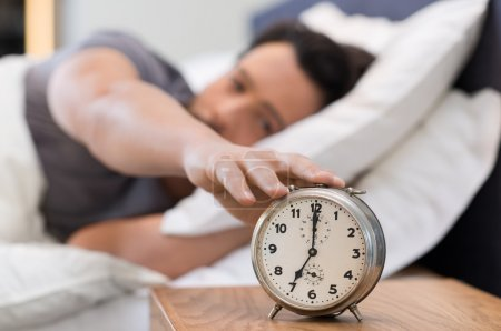 Man switching off alarm