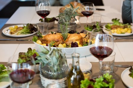 Table with food and wine set for guests.