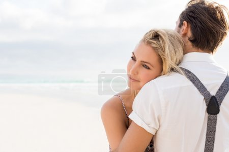 Embracing couple at sea