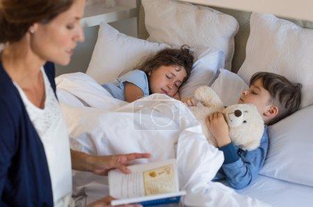 Children sleeping on bed