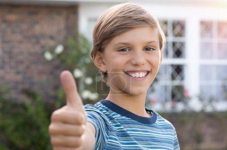 Boy giving thumb up