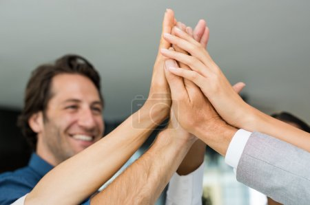 Successful people raising hands
